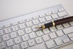 63041850 - fountain pen and computer keyboard
